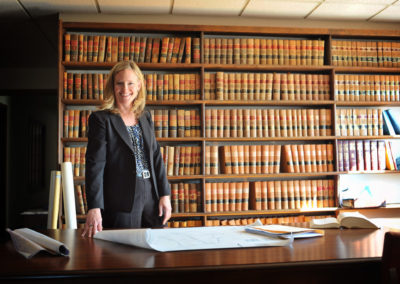 environmental portrait of female lawyer in a library