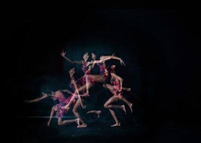 a girl in multiple moves of a dance leap with strobe lighting technique
