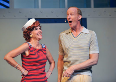 an older man and woman in a community theater production