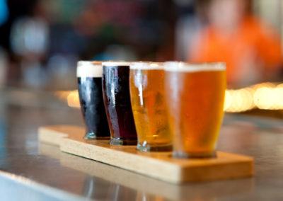 four beer samples in a beer flight