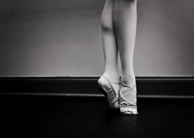 black and white photo of worn ballet shoes