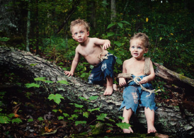 """twin boys dressed as Peter Pan """"lost boys"""" in the woods"""