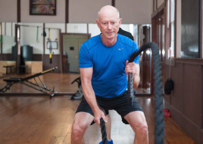 a man working out with ropes in a gym