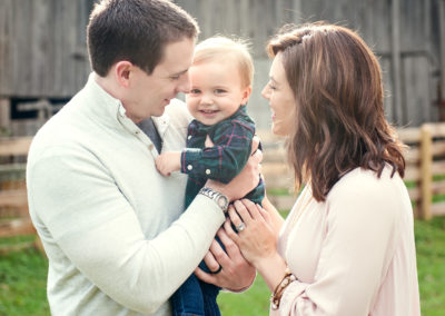 a young couple with a smiling baby between them