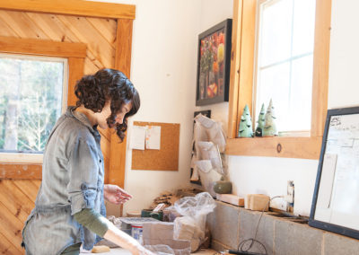 a potter working in her studio