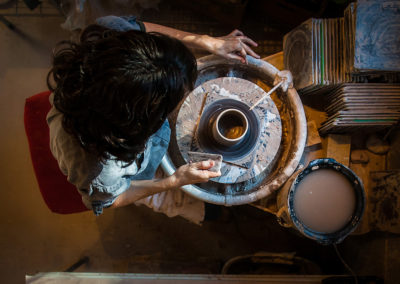 aerial view of a potter working at her potter's wheel