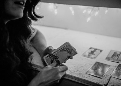 black and white image of woman reading tarot cards