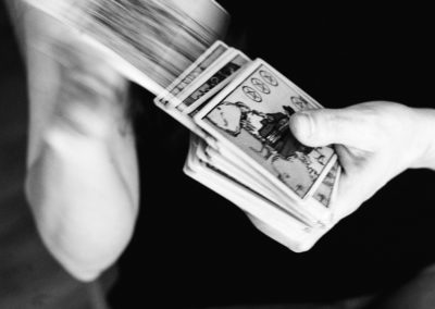 black and white image of a tarot card deck being shuffled