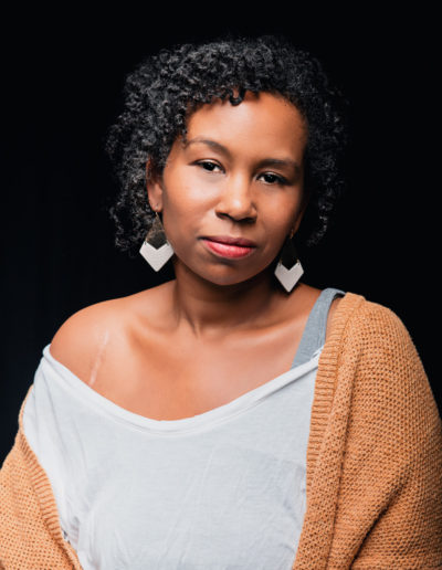 color portrait of beautiful black woman with scar from shoulder surgery