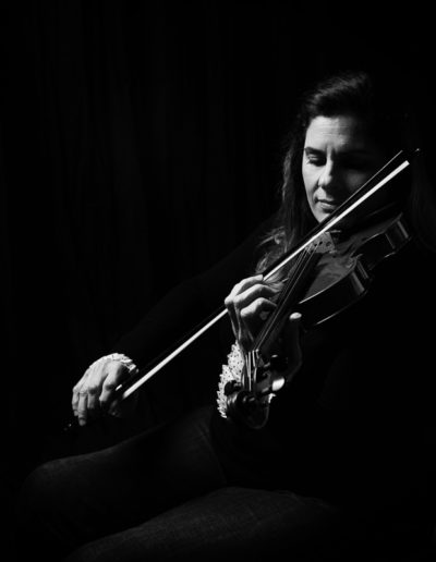 black and white image of female violinist parapalegic