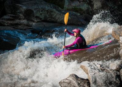female kayaker running Bull Sluice on Chattooga River