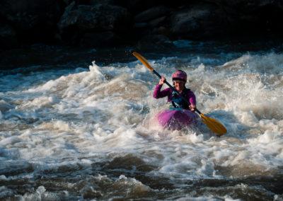 female kayaker running Bull Sluice