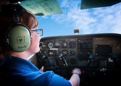 female pilot in cockpit