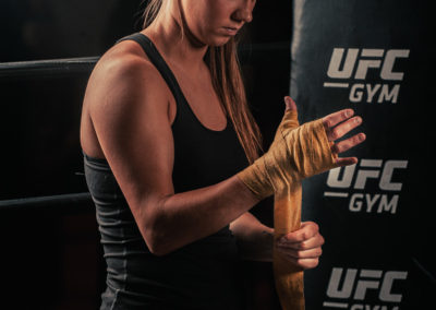female mma fighter wrapping her hands