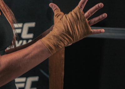 female mma wrapping her hands