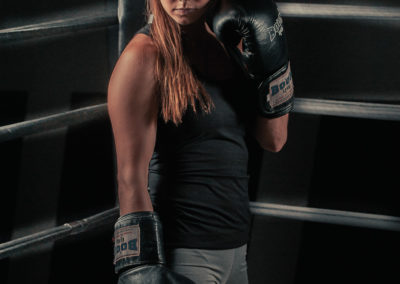 female mma fighter with glove in front of face