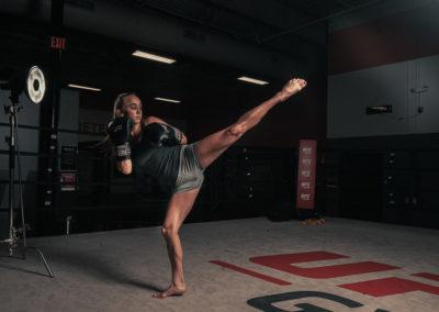 female MMA fighter training kicking